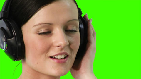 ChromaKey of a woman listening to music Footage