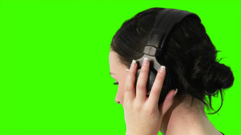 Green screen of a woman listening to music Footage