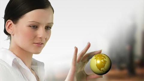 Business woman holding a Globe Footage