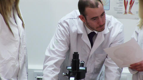 A team of scientists at work in a lab Stock Video Footage