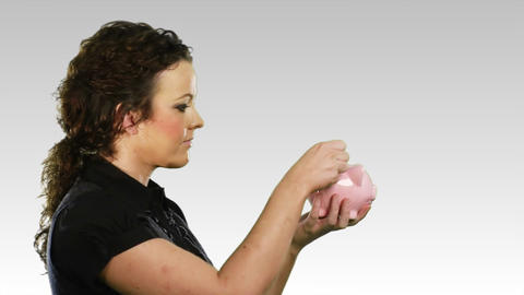 Woman with a piggy bank Footage