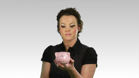 Savings money in a piggy bank Stock Video Footage