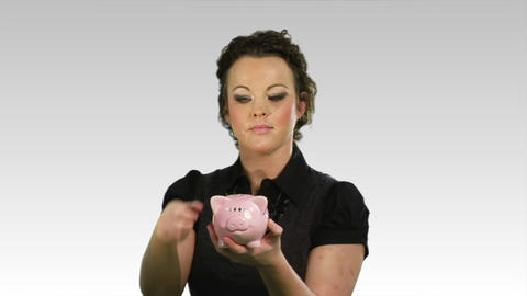 Savings money in a piggy bank Footage