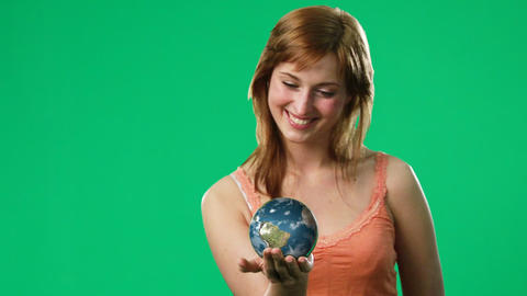 Woman Holding a Globe in her hand Footage