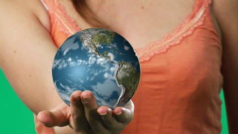 Chroma key footage of a woman holding a globe Footage