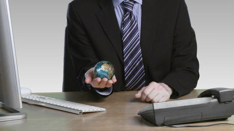 Businessman with a rotary globe in his hand Stock Video Footage