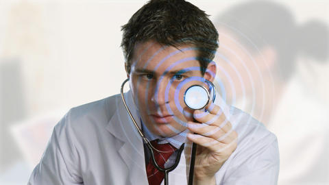Doctor listening to a stethoscope Stock Video Footage