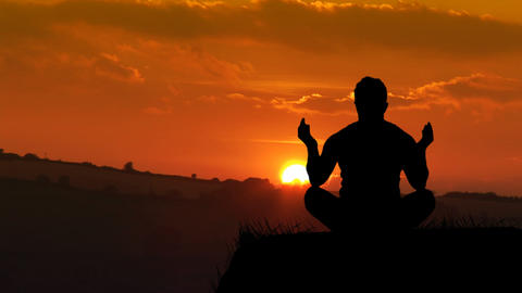 Man meditating at Sunset Footage