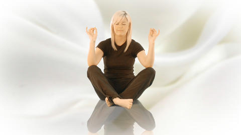 Woman practicising Yoga on her own Stock Video Footage