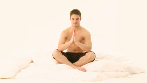 Young Handsome Man practicing Yoga Stock Video Footage
