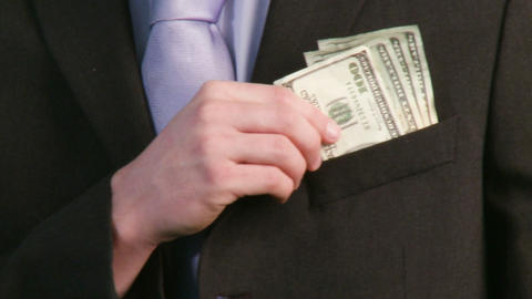 Businessman putting money in pocket Footage
