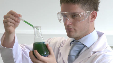 Lab Technician examining chemical Footage