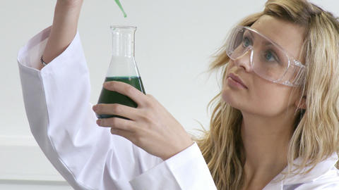 Woman looking at chemicals Footage