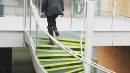 Businessman going upstairs in a building office Animation