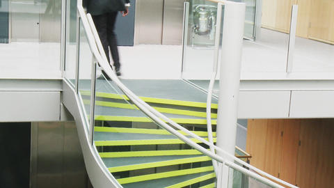 Businessman going upstairs in a building office Stock Video Footage