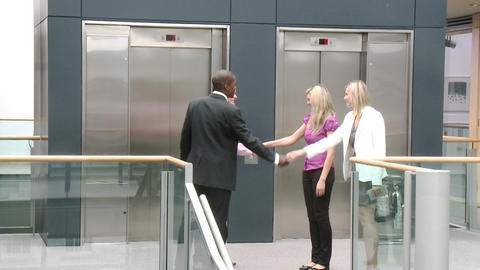Business team shaking hands in a building Animation