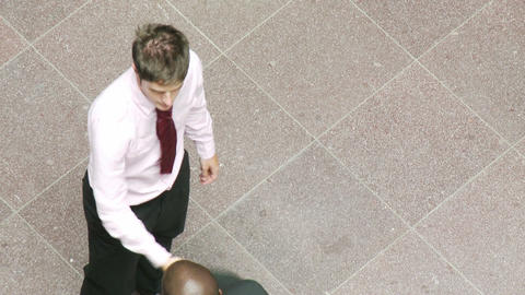 Businessmen shaking hands at work Stock Video Footage