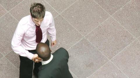 Businessmen shaking hands at work Animation