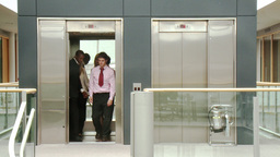 Business people leaving a lift at work Stock Video Footage