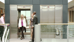 Business People Leaving A Lift At Work stock footage