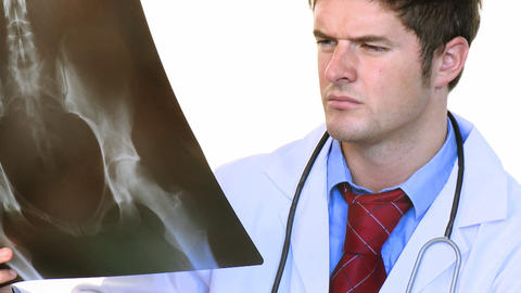 Attractive doctor studying an xray footage Stock Video Footage