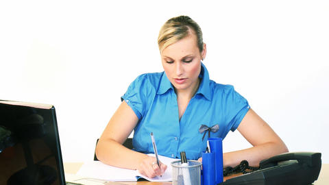 Blonde businesswoman writing reports in office Stock Video Footage