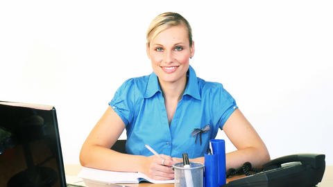 Blonde businesswoman writing reports in office Footage