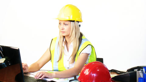 Blonde female architect working in office Footage