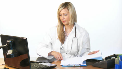 Female doctor working in hospital office Footage