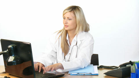 Attractive blonde doctor using a laptop in hospita Stock Video Footage