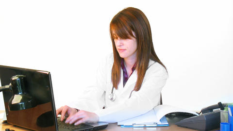 Brunette young doctor working in hospital office Footage
