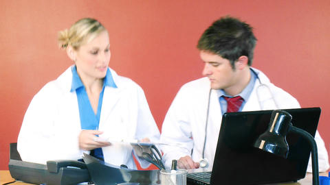 Young doctors working together in office Stock Video Footage