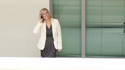 Young businesswoman talking on phone in workplace Footage