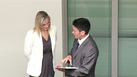 Businessman and businesswoman talking about work i Stock Video Footage