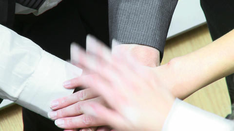 Close up of business people with hands together Footage