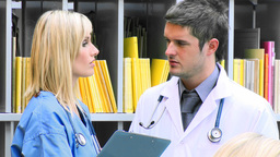 Female and male doctors talking in hospital footag Footage