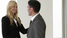 Businesswoman and businessman shaking hands in off Stock Video Footage