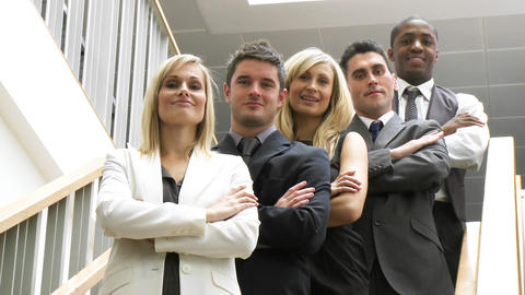 Business people in a line on stairs smiling at the Stock Video Footage