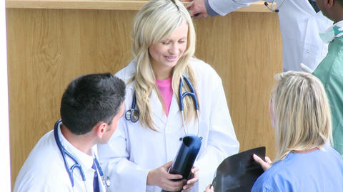 Footage of doctors studying an xray Stock Video Footage