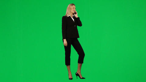 Businesswoman on phone against green screen footag Footage