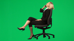 Businesswoman sitting on a chair on phone against  Footage