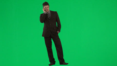 Businessman on mobile phone against green screen f Footage
