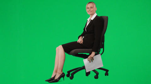Businesswoman sitting on a chair writing notes aga Stock Video Footage