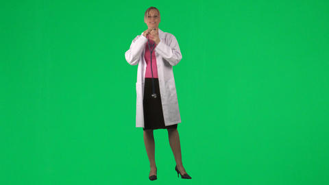 Footage of a female doctor using her stethoscope Footage