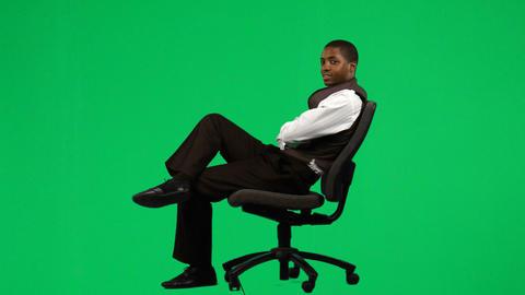 AfroAmerican Businessman Relaxing On A Chair Foota stock footage