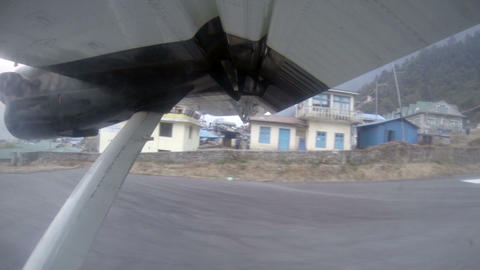 Take off on the plane from Lukla, Nepal. Airplane Stock Video Footage