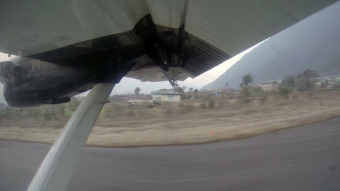Take off on the plane from Lukla, Nepal. Airplane  Footage