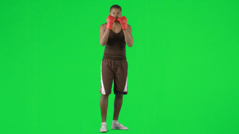 AfroAmerican man boxing against green screen foota Footage
