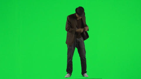 Ethnic young man dancing with a hat and a jacket f Footage