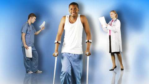 Ethnic young man walking with crutches with doctor Stock Video Footage
